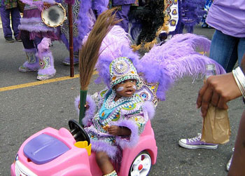 A young participant in a Mardi Gras parade in New Orleans. Ann Banks photo.