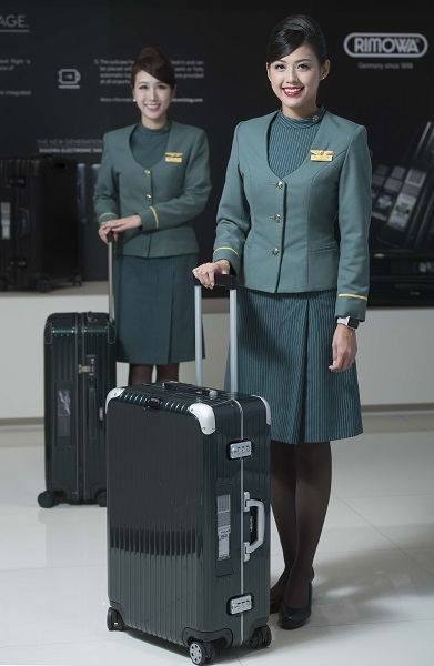 Eva Air flight attendants show off the new luggage tag system.